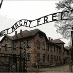 Auschwitz gate sign, work sets you free.