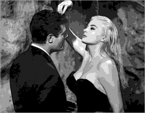 Anita Ekberg dribbles water on Marcello's head; she is life.