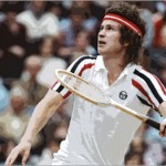 John McEnroe preparing to smash an overhead